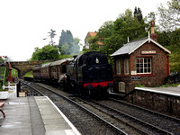 BR 2-6-4T No 80072 enters Goathland station with a train of vintage stock